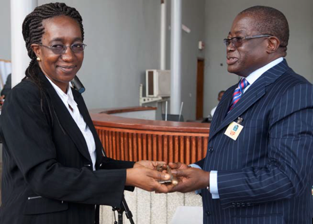 Registrar Binta Mansaray hands ceremonial key to Attorney-General and Minister of Justice, Franklyn Bai Kargbo