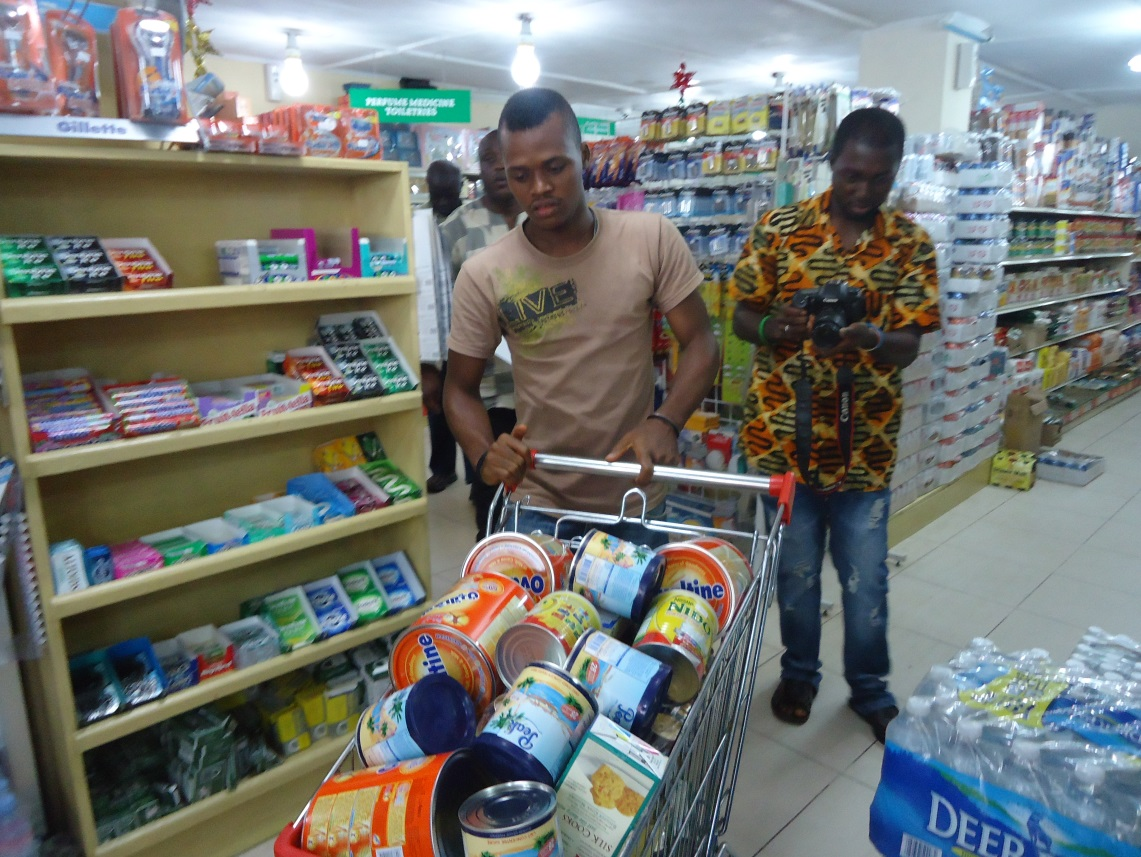 A lucky winner strides home with his goods after one minute  trolley dash