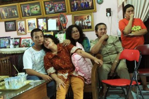 Family members of Firman Chandra Siregar, an Indonesian passenger of flight MH370, watched television at their home in Medan, Indonesia, on Sunday.