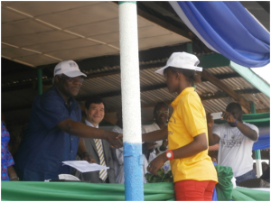 Madam Barrie presenting her position paper to President Koroma