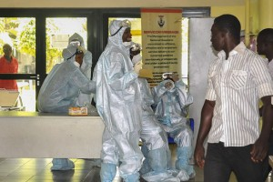 Health workers in protective clothing wait in an emergency ward as preparation for receiving any emergency Ebola patients. Credit: European Pressphoto Agency