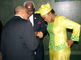 HAPPY TIMES … Ms. Miatta Kargbo seen here 'handing heads' with President Koroma