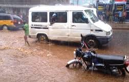 Taxis and private vehicles struggling to pass through the flooded Pademba Road yesterday