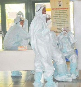 HEALTH PERSONNEL IN PROTECTIVE KITS AT THE NATIONAL HOSPITAL IN ABUJA