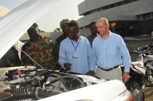 Ambassador John Hoover  inspecting  handed 24 multi-purpose vehicles and 29 motorbikes to handed over to the National Ebola Response Center by the U.S. Government