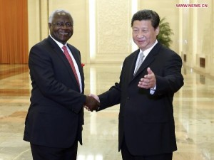 Embracing the future of strong ties: Presidents Xi Jimpin & Earnest Bai Koroma in warm handshake